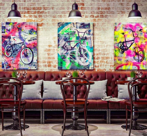 Three Freestyle BMX Art Pieces in Restaurant Setting