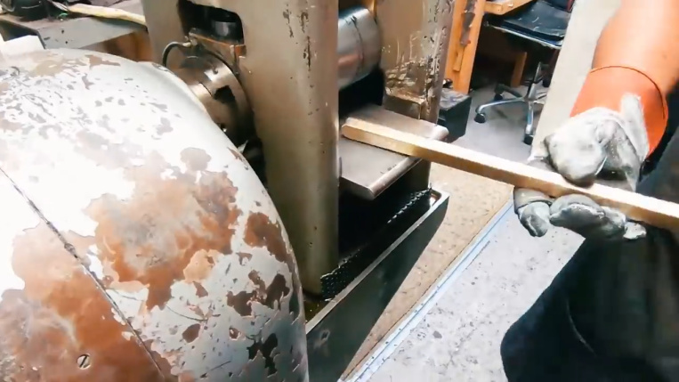 stretching gold bar to make chain
